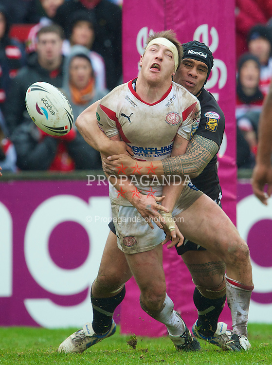 ST HELENS, ENGLAND - Friday, April 2, 2010: St Helens Saints' James Roby is tackled by Wigan Warriors' Iafeta Paleaaesina during the Super League XV Round 9 match at the Knowsley Road. This is the last ever Derby match at the old stadium. (Pic by David Rawcliffe/Propaganda)
