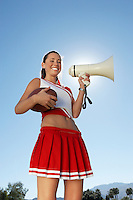 Cheerleader Holding Football and Megaphone