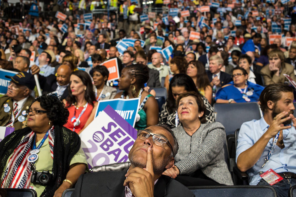 Delegates listen as San Antonio Mayor Julian Castro speaks at the Democratic National Convention on Tuesday, September 4, 2012 in Charlotte, NC.
