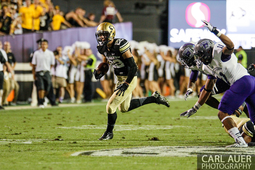 September 7th, 2013 - Colorado Buffaloes sophomore wide receiver Nelson Spruce (22) runs with the ball in the fourth quarter of the NCAA football game between the University of Central Arkansas Bears and the University of Colorado Buffaloes at Folsom Field in Boulder, CO