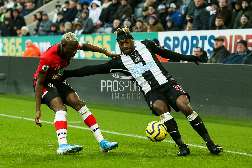 Allan Saint-Maximin (#10) of Newcastle United takes on Moussa Djenepo (#12) of Southampton during the Premier League match between Newcastle United and Southampton at St. James's Park, Newcastle, England on 8 December 2019.