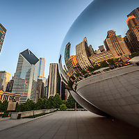 """Chicago """"The Bean"""" Cloud Gate sculpture with a reflection of downtown Chicago city buildings."""