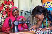 "Rahab Mbuba teaching a student some of her sewing techniques.<br /> <br /> Rahab, also known as 'Mama B"", set up and now runs a tailoring business, designing and making clothes.<br /> <br /> She attended MKUBWA enterprise training run by the Tanzania Gatsby Trust in partnership with The Cherie Blair Foundation for Women."