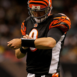 2009 August 14: Cincinnati Bengals quarterback Carson Palmer (9) looks at his wrist for a play during a preseason opener between the Cincinnati Bengals and the New Orleans Saints at the Louisiana Superdome in New Orleans, Louisiana.