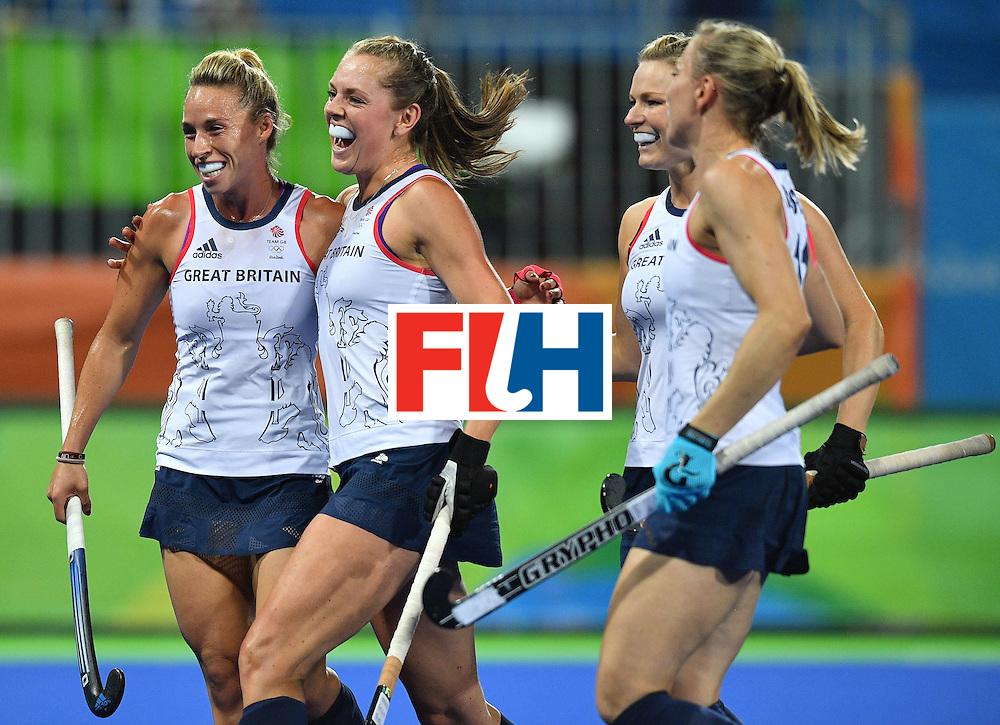 Britain's Georgie Twigg (2nd L) celebrates the opening goal with teammates during the women's quarterfinal field hockey Britain vs Spain match of the Rio 2016 Olympics Games at the Olympic Hockey Centre in Rio de Janeiro on August 15, 2016. / AFP / Carl DE SOUZA        (Photo credit should read CARL DE SOUZA/AFP/Getty Images)
