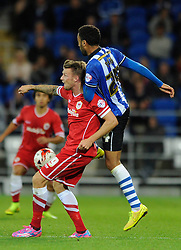 Cardiff City's Anthony Pilkington is challenged by Wigan Athletic's James Perch - Photo mandatory by-line: Dougie Allward/JMP - Mobile: 07966 386802 19/08/2014 - SPORT - FOOTBALL - Cardiff - Cardiff City Stadium - Cardiff City v Wigan Athletic - Sky Bet Championship