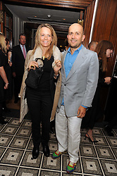 MARC QUINN and GEORGIA BYNG at Vogue's Celebation of Fashion dinner held at The Albermarle, Brown's Hotel, Albermarle Street, London on 18th September 2008.
