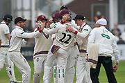 Wicket - Dom Bess of Somerset is mobbed after taking the wicket of Middlesex's Adam Vogues during the Specsavers County Champ Div 1 match between Somerset County Cricket Club and Middlesex County Cricket Club at the Cooper Associates County Ground, Taunton, United Kingdom on 26 September 2017. Photo by Graham Hunt.