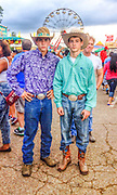 Matthew Hoffman and his cousin Justin Koch (rt), came to Memphis from Paris, Tennessee to be in the rodeo, as bull riders. The rodeo was part of the Delta Fair. The two decided to take a stroll down the midway during a break. They stumbled upon the mechanical bull and watched fair goers attempt to ride the bulls. The Delta Fair was the biggest fair they have ever been to.
