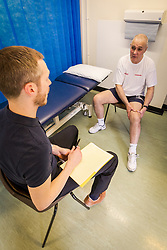 Physiotherapist with patient at health centre gym, London Borough of Enfield, Barnet, Enfield & Haringey Mental Health Trust, London UK