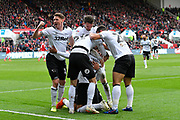 Goal - George Evans (17) of Derby County turns to the fans as punches the air as Jayden Bogle (37) of Derby County celebrates scoring a goal to give a 0-2 lead to the away team during the EFL Sky Bet Championship match between Bristol City and Derby County at Ashton Gate, Bristol, England on 27 April 2019.