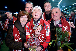 Slovenian athlete Petra Majdic with her mother, father and two brothers when she arrived home with cristal globus at the end of the nordic season 2008/2009, on March 23, 2009, at airport Jozeta Pucnika, Brnik, Slovenia. (Photo by Vid Ponikvar / Sportida)