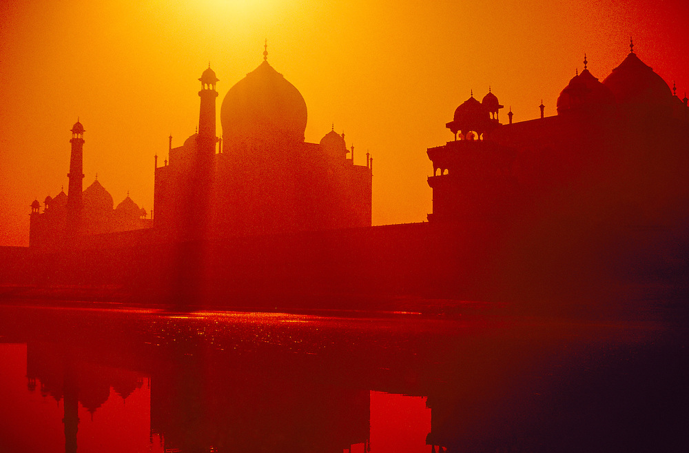 Taj Mahal in silhouette reflected in the Yamuna River at sunrise, Agra, Uttar Pradesh, India