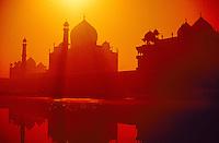 Taj Mahal in silhouette reflected in the Yamuna River at sunrise, Agra, Uttar Pradesh, India