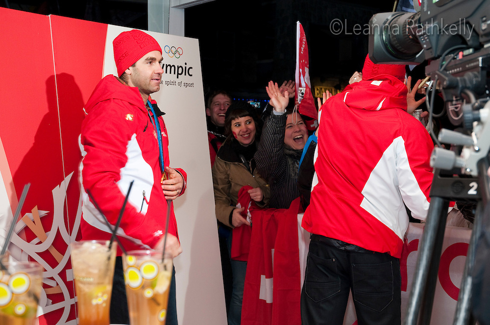 A crowd cheers for the gold medal winners, Dario Cologna and Didier Defago, during the 2010 Olympic Winter games in Whistler, BC Canada.