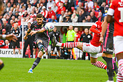 Leeds United midfielder Mateusz Klich (43) takes a shot during the EFL Sky Bet Championship match between Barnsley and Leeds United at Oakwell, Barnsley, England on 15 September 2019.