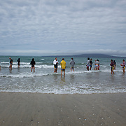 Players enter the water during the Australian teams recovery session at  Takapuna Beach at the IRB Rugby World Cup tournament, Auckland, New Zealand, 17th October 2011. Photo Tim Clayton...