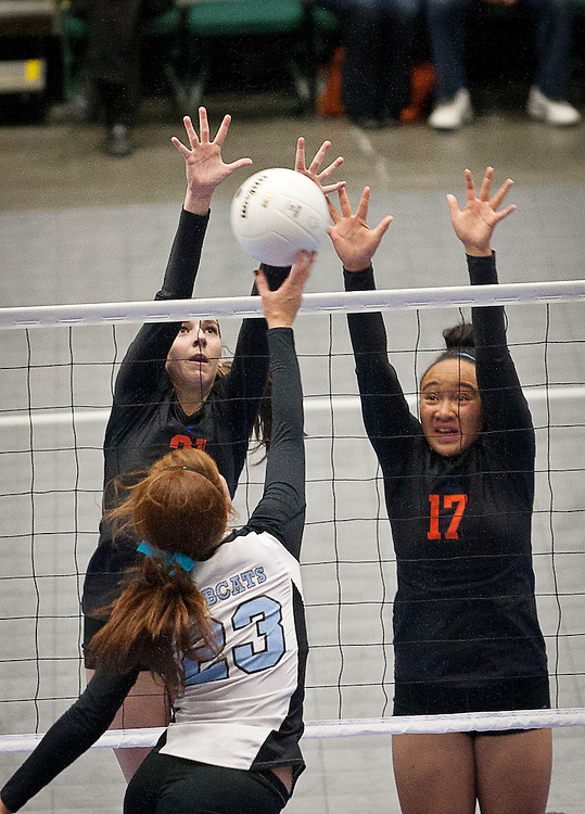 Timpview's Megan Huddelston (21) and Anessa Atvaia (17) go up for a block during the Utah State High School Volleyball 4A championship match between Skyview and Timpview in the UCCU in Orem, Saturday, Nov. 3, 2012.