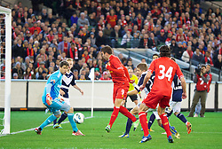MELBOURNE, AUSTRALIA - Wednesday, July 24, 2013: Liverpool's Iago Aspas scores the second goal against Melbourne Victory during a preseason friendly match at the Melbourne Cricket Ground. (Pic by David Rawcliffe/Propaganda)