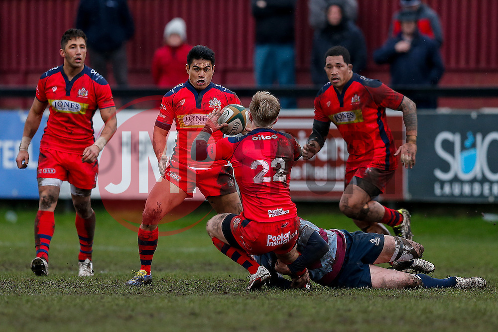 Bristol Rugby replacement Charlie Amesbury offloads to Winger David Lemi (capt) - Mandatory byline: Rogan Thomson/JMP - 06/02/2016 - RUGBY UNION - Clifton Lane - Rotherham, England - Rotherham Titans v Bristol Rugby - Greene King IPA Championship.