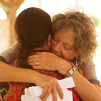 Donna Gardner, left, receives a hug from Lynn Heritage Sunday September 21, 2014 during a celebration of International Day of Peace sponsored by Grandmothers for Peace at Hugh MacRae Park in Wilmington, N.C. (Jason A. Frizzelle)