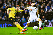 Millwall forward Tom Bradshaw (9) and Leeds United defender Ben White (5) during the EFL Sky Bet Championship match between Leeds United and Millwall at Elland Road, Leeds, England on 28 January 2020.