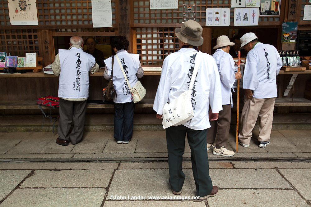 Henro Japanese Pilgrims Shop - Henro, or Japanese Buddhist pilgrims, stop for pilgrim supplies at the entrance to Okunoin.  Though the most famous trail in Japan is around Shikoku Island's 88 temples, Koya-san is another hot spot.  Nowadays it is common to undertake pilgrimages in stages, completing one cycle in a number of trips; many devotees repeat the pilgrimage - even hundreds of times. Some become so addicted to the sites and the route that they spend their entire lives on the road and end their pilgrimage only in death, a memorial stone marking the ending  of their life's journey.