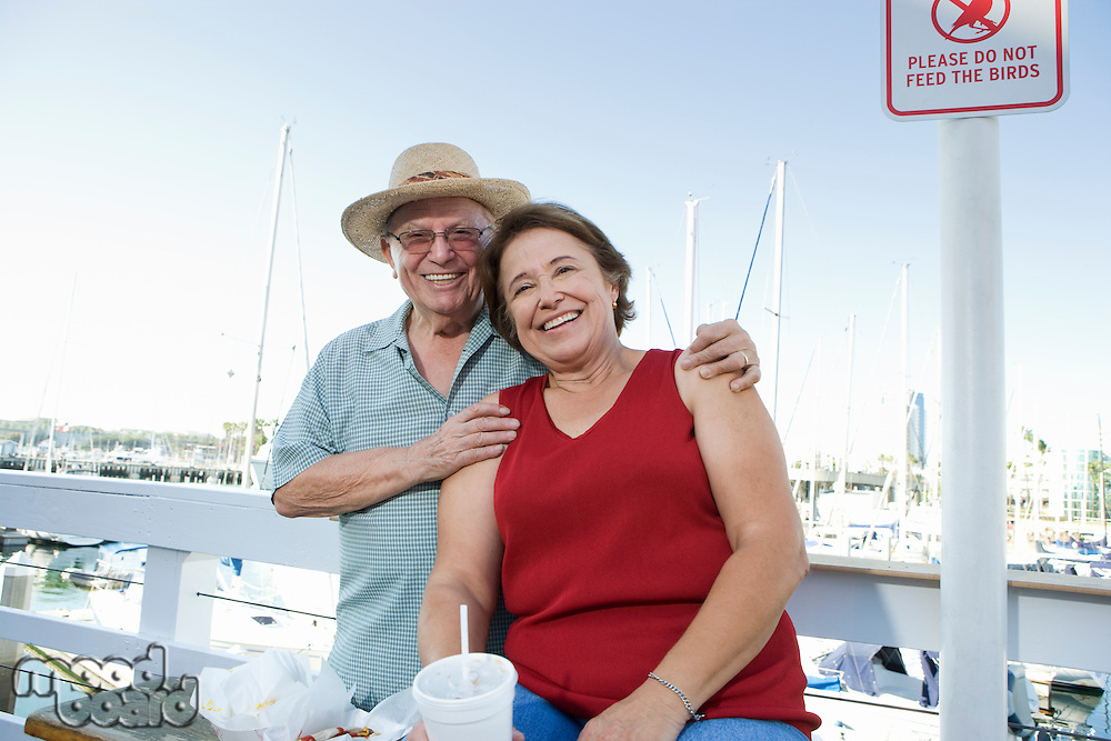 Portrait of senior couple on vacations, smiling