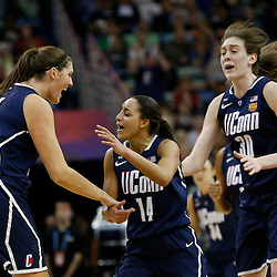 April 7, 2013; New Orleans, LA, USA; Connecticut Huskies center Stefanie Dolson (31), guard Bria Hartley (14), and forward Breanna Stewart (30) celebrate against the Notre Dame Fighting Irish during the first half in the semifinals during the 2013 NCAA womens Final Four at the New Orleans Arena. Mandatory Credit: Derick E. Hingle-USA TODAY Sports