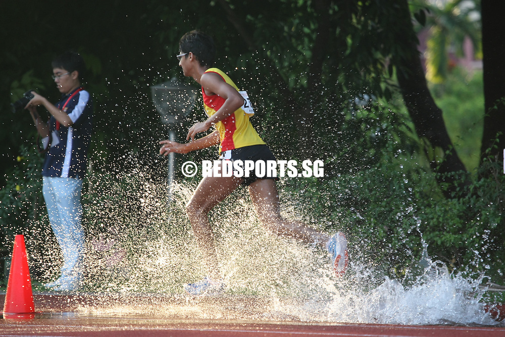 Chua Chu Kang Stadium, Friday, April 12, 2013 &mdash; Karthic Harish Ragupathy of Hwa Chong Institution (HCI) capped off a red-letter season, when he won the A Division 3,000 metres steeplechase final at the 54th National Schools Track and Field Championships. In doing so, he successfully defended his three A Division titles in cross-country, the 5,000m and the 3,000m steeplechase.<br /> <br /> Story: http://www.redsports.sg/2013/04/17/a-boys-3000m-steeplechase-karthic-hci/