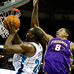 December 30, 2011; New Orleans, LA, USA; New Orleans Hornets power forward Carl Landry (24) shoots over Phoenix Suns center Channing Frye (8) during the first quarter of a game at the New Orleans Arena.   Mandatory Credit: Derick E. Hingle-US PRESSWIRE