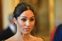 Meghan Markle chats with people inside the Drawing Room during a visit to Cardiff Castle.