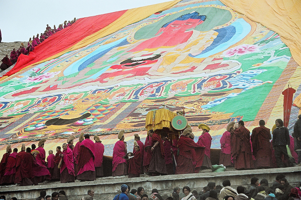 The Great Thangka of Buddha Shakyamuni is displayed on the hill in front of the Labrang monastery at the end of the Monlam Chenmo ceremonies. Xiahe, China, March/02/2007.