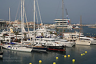 Ultra-rich spectators dock their luxury boats in the middle of the action at the superyacht marina in Port America's Cup; Valencia, Spain.
