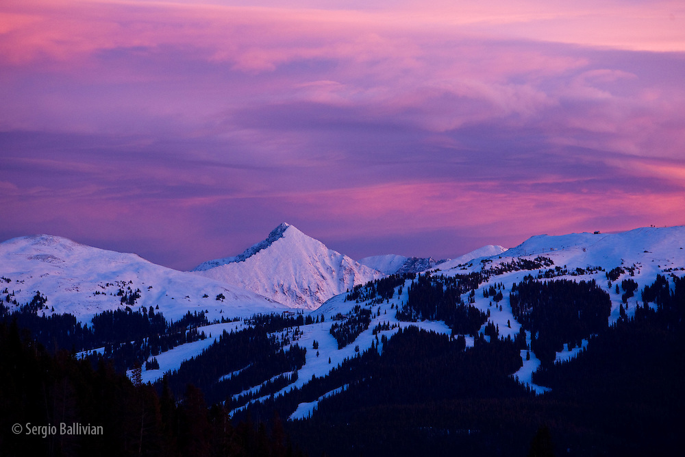 A red sunset bathes the snow-covered peaks near Copper Mountain Resort in Colorado.