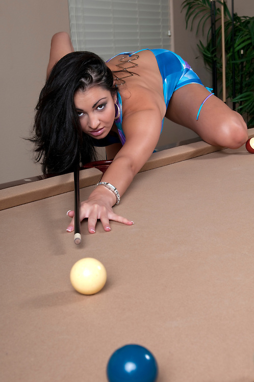 Very sexy girl playing pool and flirting.