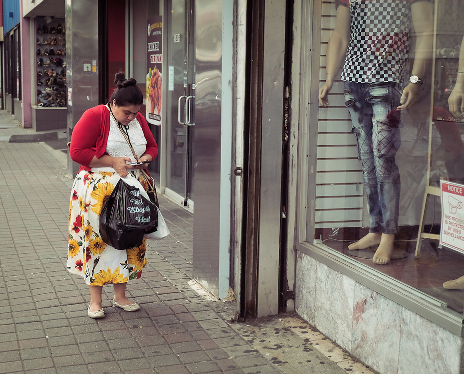 Woman dressed in colorful clothes shopping on Bergenline.