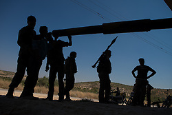 Syria<br /> Members of the Free Syrian Army chatting in front of a  T-72 tank parked in a secret location close to al-rami village.<br /> Rebels and activists have been reporting heavy clashes between rebels and government forces in Idlib province as government troops are trying to take control of the highway that leads to the neighbouring Latakia province, Idlib<br /> Syria<br /> Saturday, 22nd June 2013<br /> Picture by Daniel Leal-Olivas / i-Images