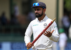 August 6, 2017 - Colombo, Sri Lanka - Indian captain Virat kohli walks off with a stump in his hand after India defeated Sri Lanka by an innings and 53 runs during the 4th Day's play in the 2nd Test match between Sri Lanka and India at the SSC international cricket stadium at the capital city of Colombo, Sri Lanka on Sunday 6 August 2017. (Credit Image: © Tharaka Basnayaka/NurPhoto via ZUMA Press)