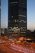 Israel, Tel Aviv, Hakirya High rise building at dusk