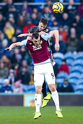 Jonny Evans of Leicester City beats Chris Wood of Burnley to a header - Mandatory by-line: Robbie Stephenson/JMP - 19/01/2020 - FOOTBALL - Turf Moor - Burnley, England - Burnley v Leicester City - Premier League