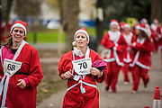 Not everyone enjoys it nearing the finish - The London Santa Run 2015 in Battersea Park - 2,000 Santa's take part in an annual 'Red & White' bearded 'charge' around Battersea Park in a 6k festive charity fun run. The runners are of all ages and abilities and many run at a very slow pace but enjoy the event and the cause. The Santa Run is organised to raise funds for Disability Snowsport UK, a national charity helping people with disabilities to access the thrill of snowsports. The charity ensures that children and adults, with a range of disabilities (including cerebral palsy, Down's syndrome,  visual impairment and autism), can access programs across the UK to enable them to make friends, improve their confidence and have fun through a sport which they would otherwise be excluded from.