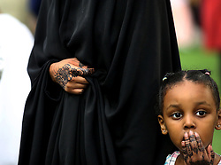 A young Muslim and her mother have henna patterns on their hands to celebrate the holiday of Eid Tuesday, August 21, 2018, at U.S. Bank Stadium in Minneapolis, MN, USA, tocelebrate Eid ul-Adha, the organization Super Eid hopes to bring together over 50,000 Muslims to pray. Photo by David Joles/Minneapolis Star Tribune/TNS/ABACAPRESS.COM