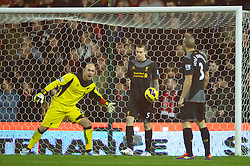 STOKE-ON-TRENT, ENGLAND - Boxing Day Wednesday, December 26, 2012: Liverpool's goalkeeper Jose Reina and Daniel Agger look dejected as Stoke City score the first equalising goal to level the scores at 1-1 during the Premiership match at the Britannia Stadium. (Pic by David Rawcliffe/Propaganda)