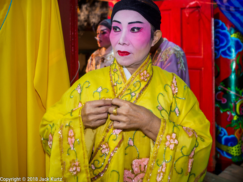 "12 JANUARY 2018 - BANGKOK, THAILAND: Chinese opera performers put on their costumes before a performance at the Chaomae Thapthim Shrine in the Dusit district of Bangkok. Many Chinese shrines and temples host Chinese operas during the Lunar New Year. Lunar New Year is 16 February this year and opera troupes are starting their holiday engagements at local Chinese temples and shrines. The new year will be the ""Year of the Dog."" Chinese New Year, also called Lunar New Year or Tet, is widely celebrated in Chinese communities around the world. Thailand has a large Chinese community and Lunar New Year is an important holiday.     PHOTO BY JACK KURTZ"