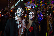 New York, NY - 31 October 2015. A couple made up to look like calavera catrinas in the annual Greenwich Village Halloween Parade. La calavera catrina is traditionally a female figure, with a skull for a face.