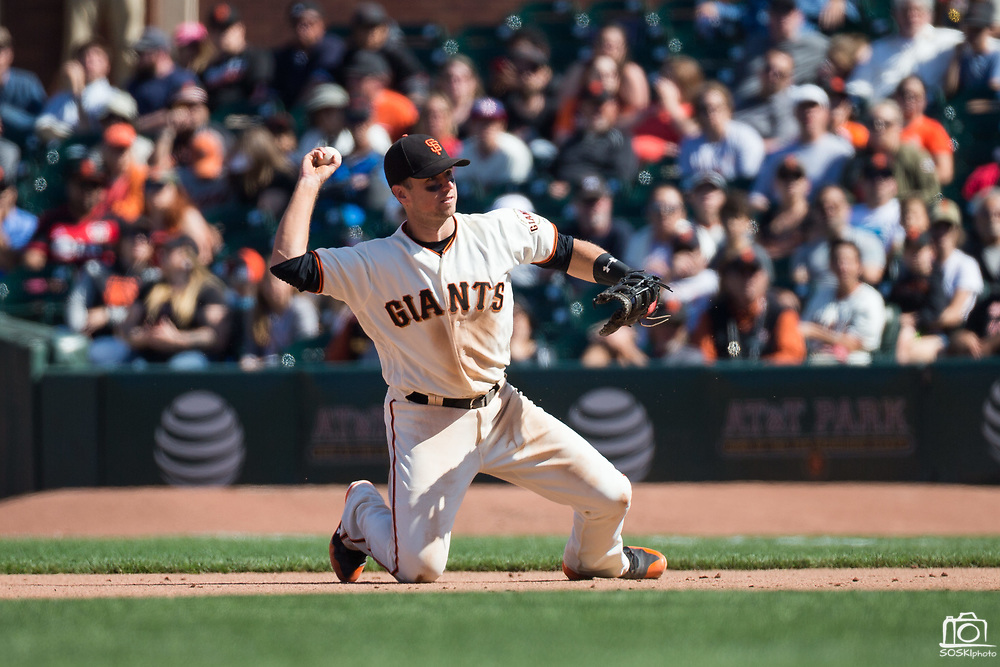 San Francisco Giants first baseman Buster Posey (28) fields a ground ball against the Arizona Diamondbacks at AT&T Park in San Francisco, California, on August 6, 2017. (Stan Olszewski/Special to S.F. Examiner)