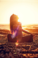 Meditating woman in the bliss of light energy.