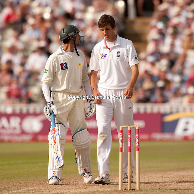 Zulqarnain Haider past bowler Steven Finn (right) during the second npower Test Match between England and Pakistan at Edgbaston, Birmingham.  Photo: Graham Morris (Tel: +44(0)20 8969 4192 Email: sales@cricketpix.com) 08/08/10