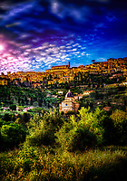 """The evening sun radiates over the hilltop of Cortona""... <br />
